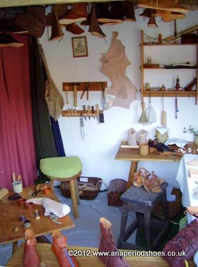 a fully equipped medieval shoe maker's workshop with tools